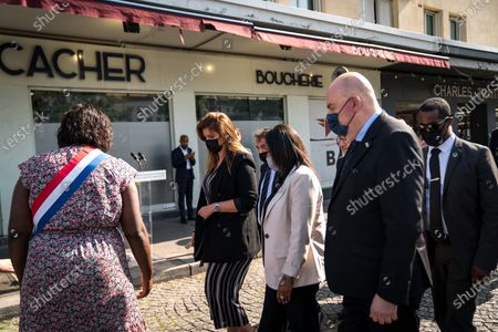Stock Image of Marlene Schiappa and Pnina Tamano Shata, Israeli Minister of Immigration and Integration, ugly a wreath of flowers in front of the Hyper Kosher on Tuesday in tribute to the victims of the attack.