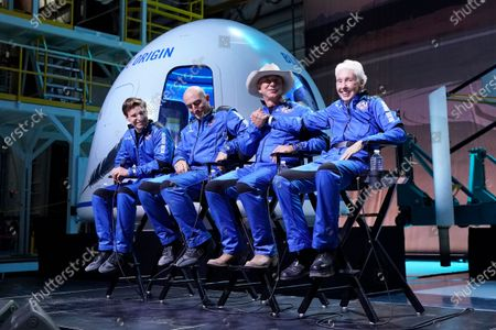 Oliver Daemen, from left, Mark Bezos, Jeff Bezos, founder of Amazon and space tourism company Blue Origin, and Wally Funk, right, participates in a post launch briefing where they discussed their flight experience aboard the Blue Origin New Shepard rocket at its spaceport near Van Horn, Texas