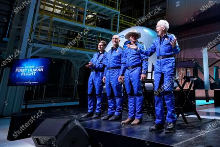 Oliver Daemen, from left, Mark Bezos, Jeff Bezos, founder of Amazon and space tourism company Blue Origin, and Wally Funk, right, participate in a post launch briefing where they discussed their flight experience aboard the Blue Origin New Shepard rocket at its spaceport near Van Horn, Texas