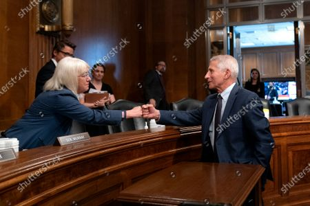 Anthony Fauci, director of the National Institute of Allergy and Infectious Diseases, fist bumps Senator Patty Murray (D-WA) following a Senate Health, Education, Labor, and Pensions Committee hearing in Washington, DC, USA, 20 July 2021.