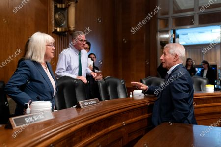 Anthony Fauci, director of the National Institute of Allergy and Infectious Diseases, speaks to Senator Patty Murray (D-WA) and Senator Richard Burr (R-NC) following a Senate Health, Education, Labor, and Pensions Committee hearing in Washington, DC, USA, 20 July 2021.