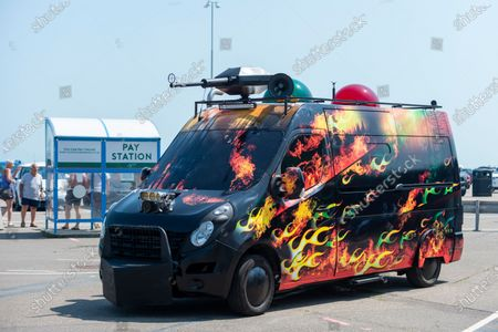 """""""Climate Emergency Services"""", 2021, by Mike Stubbs, a memorably customised hot rod vehicle. Concealed within is a laboratory containing plants and the latest technologies for sensing air quality. Preview of The Plot exhibition, the fifth Creative Folkestone Triennial. Folkestone has no publicly subsidised art gallery, so artists were invited to use public spaces to create new artworks in the seaside town. Over 20 works by artists including Assemble, Rana Begum, Gilbert & George, Atta Kwami, Pilar Quinteros, and Richard Deacon are on display 22 July to 2 November 2021."""