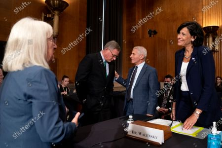 United States Senator Patty Murray (Democrat of Washington), Chairman, US Senate Health, Education, Labor and Pensions Committee, from left, US Senator Richard Burr (Republican of North Carolina), Ranking Member, US Senate Committee on Health, Education, Labor, and Pensions, Dr. Anthony Fauci, director of the National Institute of Allergy and Infectious Diseases, and Rochelle Walensky, Director of the Centers for Disease Control and Prevention, speak prior to a Senate Health, Education, Labor, and Pensions Committee hearing at the Dirksen Senate Office Building in Washington.