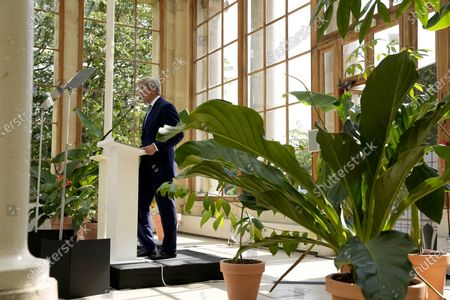 Special Presidential Envoy for Climate John Kerry delivers a policy speech in the Nash Conservatory at the Royal Botanic Gardens, Kew, in west, London, . Kerry has called on China to join America in urgently cutting greenhouse gas emissions and described the international alliances that rebuilt Europe after World War II as a model for fighting climate change. Kerry challenged global leaderson Tuesday to accelerate the actions needed to curb rising temperatures and pull the world back from the edge of the abyss