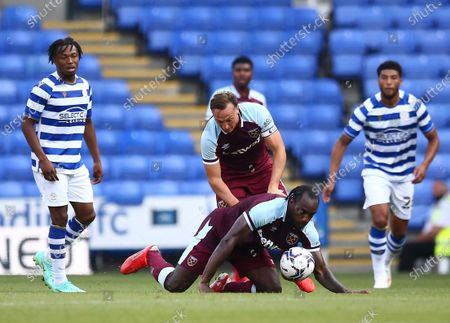 Michail Antonio of West Ham United collides with with team-mate Mark Noble