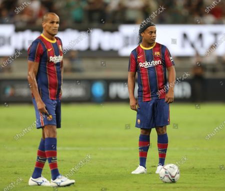 Stock Picture of Ronaldinho (R) and Rivaldo of Barcelona react during the El Clasico Legends match between Real Madrid and Barcelona at Bloomfield stadium in Tel Aviv, Israel, 20 July 2021.