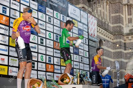 Belgian Tim Merlier of Alpecin-Fenix, British Mark Cavendish of Deceuninck - Quick-Step and Belgian Jasper Philipsen of Alpecin-Fenix celebrate on the podium of the Natourcriterium Roeselare cycling race, Tuesday 20 July 2021 in Roeselare. The contest is a part of the traditional 'criteriums', local races in which mainly cyclists who rode the Tour de France compete.
