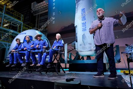 Chef Jose Andres, right, makes comments as Oliver Daemen, left, Mark Bezos, Jeff Bezos, founder of Amazon and space tourism company Blue Origin and Wally Funk, second from right, look on following the flight of the New Shepard rocket from the spaceport near Van Horn, Texas, . Andres was awarded a Courage and Civility award during the briefing