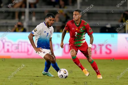Stock Picture of Costa Rica forward Johan Venegas (7) and Suriname defender Damil Dankerlui (2) vie for control of the ball during the first half of a CONCACAF Gold Cup Group C soccer match, in Orlando, Fla