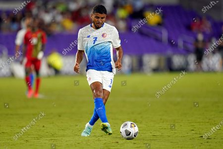 Costa Rica forward Johan Venegas (7) moves the ball against Suriname during the first half of a CONCACAF Gold Cup Group C soccer match, in Orlando, Fla