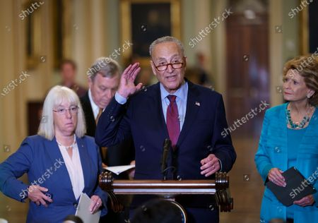 Senate Majority Leader Chuck Schumer, D-N.Y., joined from left by Assistant Majority Leader Patty Murray, D-Wash., Majority Whip Dick Durbin, D-Ill., and Sen. Debbie Stabenow, D-Mich., talks about his plans for a procedural vote tomorrow on the bipartisan infrastructure deal senators brokered with President Joe Biden, at the Capitol in Washington