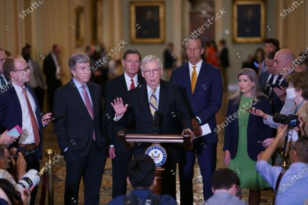 Senate Minority Leader Mitch McConnell, R-Ky., joined from left by, Sen. Roy Blunt, R-Mo., Sen. John Barrasso, R-Wyo., Minority Whip John Thune, R-S.D., and Sen. Joni Ernst, R-Iowa, speaks with reporters following a weekly strategy luncheon, at the Capitol in Washington