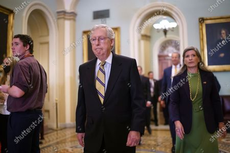 Senate Minority Leader Mitch McConnell, R-Ky., joined at right by Sen. Joni Ernst, R-Iowa, arrives to meet with reporters following a weekly strategy luncheon, at the Capitol in Washington