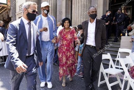 Actress Marla Gibbs, third left, is escorted back to her Hollywood Walk of Fame ceremony after suffering a heat spell during her speech, in Los Angeles. Gibbs left the stage for about 15 minutes before returning to receive her Walk of Fame star