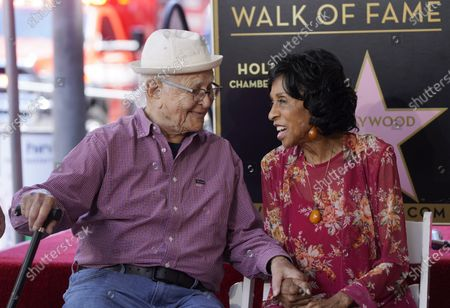 """Writer/producer Norman Lear, left, joins hands with actress Marla Gibbs during a ceremony to award her a star on the Hollywood Walk of Fame, in Los Angeles. Gibbs was a cast member on Lear's television sitcom """"The Jeffersons"""