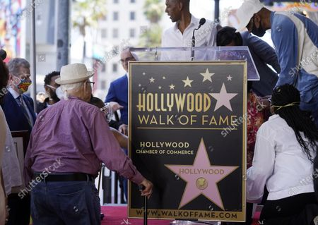 """Writer/producer Norman Lear, left, approaches the stage after actress Marla Gibbs suffered a heat spell during her Hollywood Walk of Fame ceremony, in Los Angeles. Gibbs left the stage for about 15 minutes before returning to receive her Walk of Fame star. Gibbs was a cast member in Lear's television sitcom """"The Jeffersons"""