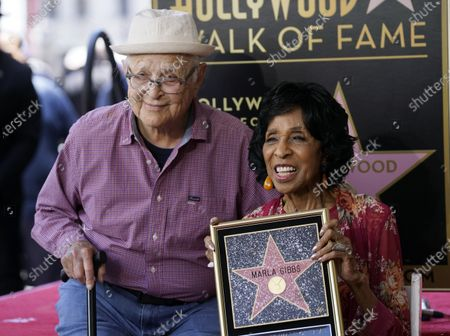 """Writer/producer Norman Lear, left, poses with actress Marla Gibbs after she received a star on the Hollywood Walk of Fame, in Los Angeles. Gibbs was a cast member on Lear's television sitcom """"The Jeffersons"""