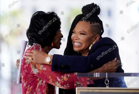 Actress Marla Gibbs, left, gets a hug from speaker Tisha Campbell during a ceremony to award Gibbs a star on the Hollywood Walk of Fame, in Los Angeles