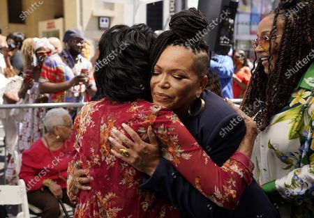 Marla Gibbs, left, gets a hug from actress Tisha Campbell before Giggs received a star on the Hollywood Walk of Fame, in Los Angeles