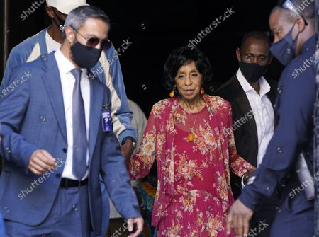 Stock Image of Actress Marla Gibbs, center, is escorted back to her Hollywood Walk of Fame ceremony after suffering a heat spell during her speech, in Los Angeles. Gibbs left the stage for about 15 minutes before returning to receive her Walk of Fame star