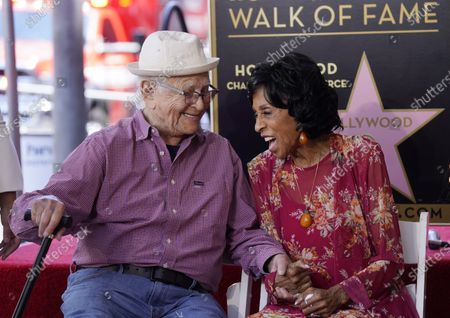 """Stock Image of Actress Marla Gibbs, right, shares a laugh with writer/producer Norman Lear during a ceremony to award her a star on the Hollywood Walk of Fame, in Los Angeles. Gibbs was a cast member on Lear's television sitcom """"The Jeffersons"""