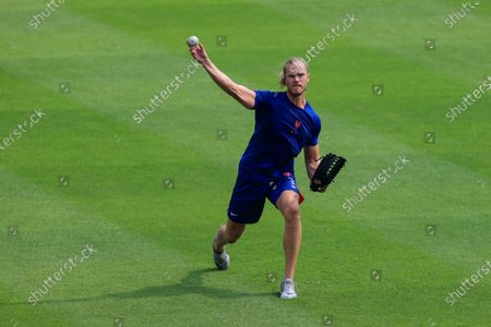 Stock Photo of New York Mets' Noah Syndergaard throws in the outfield prior to a baseball game against the Cincinnati Reds in Cincinnati