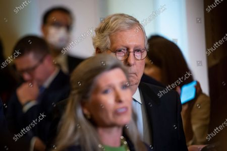 United States Senate Minority Leader Mitch McConnell (Republican of Kentucky) listens while United States Senator Joni Ernst (Republican of Iowa) offers remarks following the Republican Senate luncheon at the US Capitol in Washington, DC,.