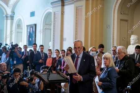 United States Senate Majority Leader Chuck Schumer (Democrat of New York), left, and United States Senator Patty Murray (Democrat of Washington), right, arrive at the lectern for the Democratic Senate luncheon at the US Capitol in Washington, DC,.