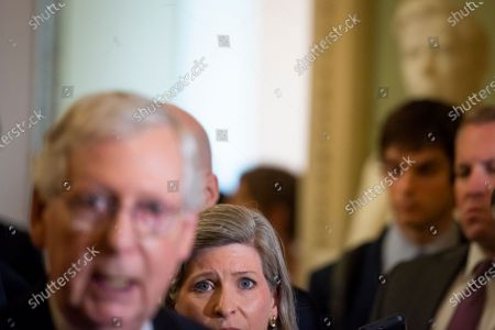 United States Senator Joni Ernst (Republican of Iowa) listens while United States Senate Minority Leader Mitch McConnell (Republican of Kentucky) offers remarks following the Republican Senate luncheon at the US Capitol in Washington, DC,.