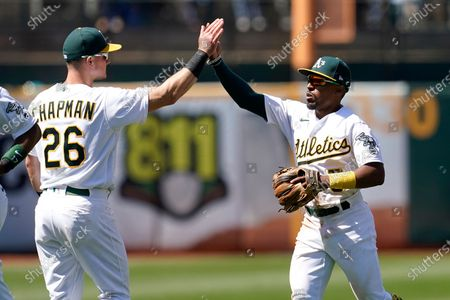 Oakland Athletics' Matt Chapman, left, celebrates with Tony Kemp after the Athletics defeated the Los Angeles Angels in a baseball game in Oakland, Calif