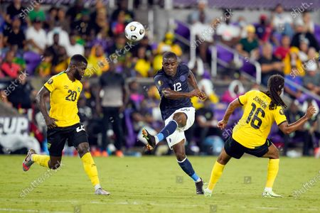 Costa Rica forward Joel Campbell (12) passes the ball to a teammate between Jamaica defender Kemar Lawrence (20) and midfielder Daniel Johnson (16) during the first half of a CONCACAF Gold Cup Group C soccer match, in Orlando, Fla