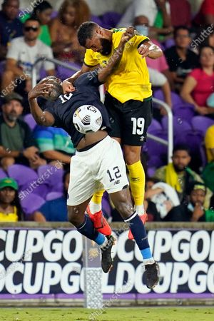 Costa Rica forward Joel Campbell (12) and Jamaica defender Adrian Morrison (19) vie for control of a head ball during the second half of a CONCACAF Gold Cup Group C soccer match, in Orlando, Fla