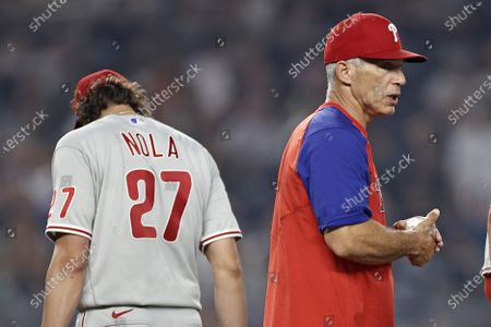 Philadelphia Phillies manager Joe Girardi holds the ball after removing pitcher Aaron Nola during the sixth inning of the team's baseball game against the New York Yankees, in New York