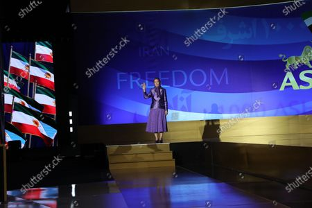 Free Iran World Summit Day 3. Maryam Rajavi, President of the National Council of Resistance of Iran (NCRI), paying tribute to 30,000 members of the principle Iranian opposition movement, the Mojahedin-e Khalq (MEK), massacred in 1988. Mrs. Rajavi later addressed the third day of the Free Iran World Summit in Ashraf 3 near Tirana, Albania. She said Khamenei's installing of Ebrahim Raisi and consolidating power within the regime was a combative and repressive configuration as fortification against the uprisings.