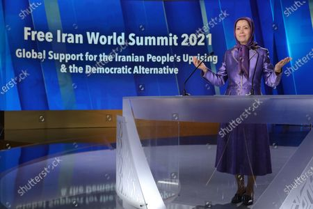 Free Iran World Summit Day 3. Maryam Rajavi, President of the National Council of Resistance of Iran (NCRI), paying tribute to 30,000 members of the principle Iranian opposition movement, the Mojahedin-e Khalq (MEK), massacred in 1988. Mrs. Rajavi later addressed the third day of the Free Iran World Summit in Ashraf 3 near Tirana, Albania. She said Khamenei's installing of Ebrahim Raisi and consolidating power within the regime was a combative and repressive configuration as fortification against the uprisings. Tirana, ALBANIA - 12/07/2021..