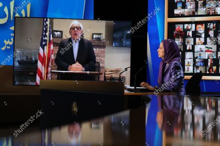Free Iran World Summit Day 3. Maryam Rajavi, President of the National Council of Resistance of Iran (NCRI), listening to Amb. John Bolton, President Trumps National Security Advisor. Maryam Rajavi, President of the National Council of Resistance of Iran (NCRI), paying tribute to 30,000 members of the principle Iranian opposition movement, the Mojahedin-e Khalq (MEK), massacred in 1988. Mrs. Rajavi later addressed the third day of the Free Iran World Summit in Ashraf 3 near Tirana, Albania. She said Khamenei's installing of Ebrahim Raisi and consolidating power within the regime was a combative and repressive configuration as fortification against the uprisings.