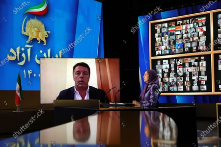 Free Iran World Summit Day 3. Maryam Rajavi, President of the National Council of Resistance of Iran (NCRI), listening to Matteo Renzi, the former Italian Prime Minister. Maryam Rajavi, President of the National Council of Resistance of Iran (NCRI), paying tribute to 30,000 members of the principle Iranian opposition movement, the Mojahedin-e Khalq (MEK), massacred in 1988. Mrs. Rajavi later addressed the third day of the Free Iran World Summit in Ashraf 3 near Tirana, Albania. She said Khamenei's installing of Ebrahim Raisi and consolidating power within the regime was a combative and repressive configuration as fortification against the uprisings.