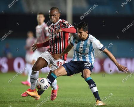 Leonardo Sigali of Argentina's Racing Club, right, and Marquinhos of Brazil's Sao Paulo compete for the ball during a Copa Libertadores round of 16 second leg soccer match in Buenos Aires, Argentina