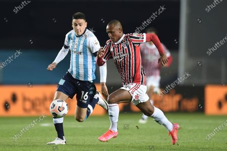 Marquinhos of Brazil's Sao Paulo, right, and Mauricio Martínez of Argentina's Racing Club go for the ball during a Copa Libertadores round of 16 second leg soccer match in Buenos Aires, Argentina