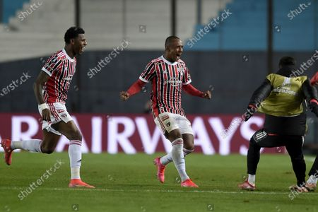 Marquinhos of Brazil's Sao Paulo, center, celebrates scoring his side's 2nd goal against Argentina's Racing Club during a Copa Libertadores round of 16 second leg soccer match in Buenos Aires, Argentina