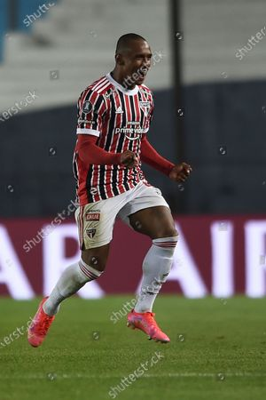 Stock Image of Marquinhos of Brazil's Sao Paulo celebrates scoring his side's 2nd goal against Argentina's Racing Club during a Copa Libertadores round of 16 second leg soccer match in Buenos Aires, Argentina