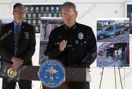 LAPD Chief Michel Moore provides an update into the June 30 fireworks blast in a Los Angeles neighborhood that injured 17 and destroyed an LAPD bomb disposal truck. At left is ATF Special Agent Michael Hoffman. Photographed at LAPD Headquarters on Monday, July 19, 2021 in Los Angeles, CA. (Myung J. Chun / Los Angeles Times)