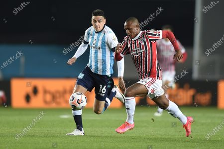 Mauricio Martinez (L) of Racing Club in action against Marcus Vinicius (R) of Sao Paulo during the Copa Libertadores soccer match between Racing Club and Sao Paulo at Presidente Peron Stadium in Avellaneda, Argentina, 20 July 2021.