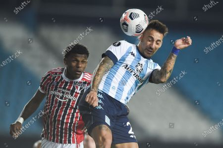 Juan Caceres (R) of Racing Club in action against Robert Arboleda (L) of Sao Paulo during the Copa Libertadores soccer match between Racing Club and Sao Paulo at Presidente Peron Stadium in Avellaneda, Argentina, 20 July 2021.