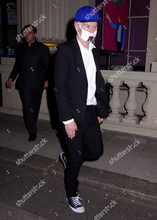 John McEnroe seen leaving Oswald's after having dinner with a friend