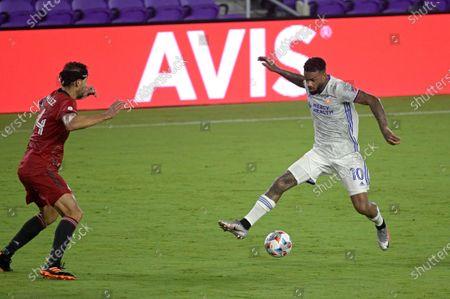 Cincinnati forward Jurgen Locadia (10) controls a ball in front of Toronto FC defender Omar Gonzalez (44) during the second half of an MLS soccer match, in Orlando, Fla