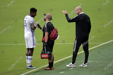 Stock Picture of Cincinnati head coach Jaap Stam, right, talks to defender Gustavo Vallecilla (5) during the first half of an MLS soccer match against Toronto FC, in Orlando, Fla