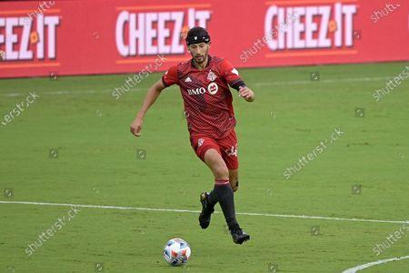 Toronto FC defender Omar Gonzalez (44) controls a ball during the first half of an MLS soccer match against FC Cincinnati, in Orlando, Fla