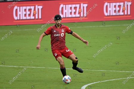 Stock Photo of Toronto FC defender Omar Gonzalez (44) controls a ball during the first half of an MLS soccer match against FC Cincinnati, in Orlando, Fla