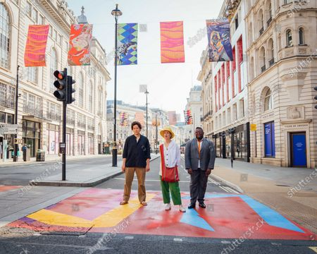 Stock Photo of Royal Academy Artists Michael Armitage, Vanessa Jackson, Isaac Julien CBE attend The Piccadilly Art Takeover.The Piccadilly Art Takeover was unveiled today in London - a large-scale public art commission of the iconic area in the capital, with artists associated with the Royal Academy of Arts designing flags, pedestrian crossings and filmed pieces for the 780 sqm Piccadilly Lights. The takeover marks the beginning of a season of free, accessible public art in the area.